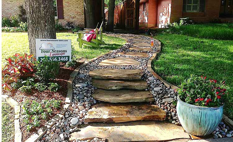 Flagstone Sidewalk with River Rock Lining