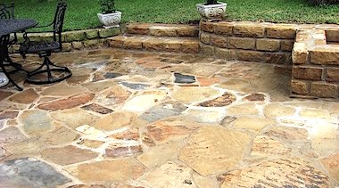Flagstone Patio with Stone Wall